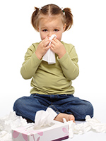 photo of child with tissues